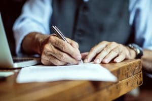 elderly-man-writing