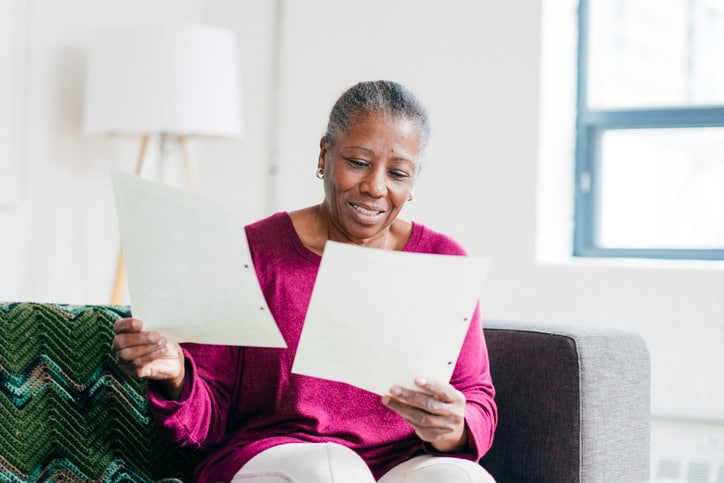 woman-looking-at-estate-planning-checklist